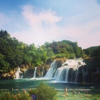 swim next to a waterfall